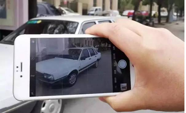 A picture of people taking a photo of illegal parking